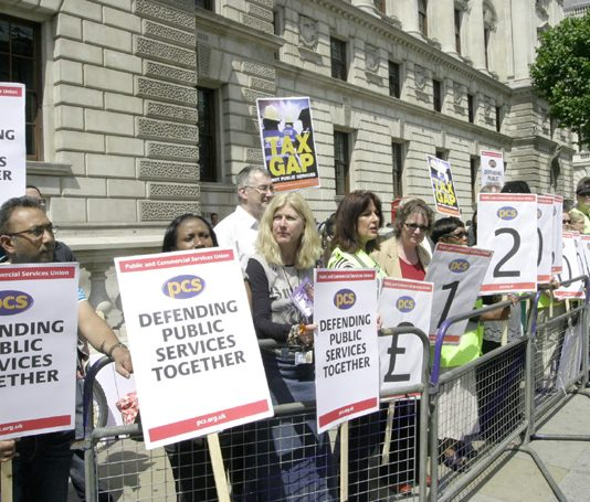 PCS members outside the Treasury yesterday highlight the £120 billion in outstanding tax debts owed by big business