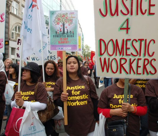Domestic workers marching against low pay on the May Day march in London