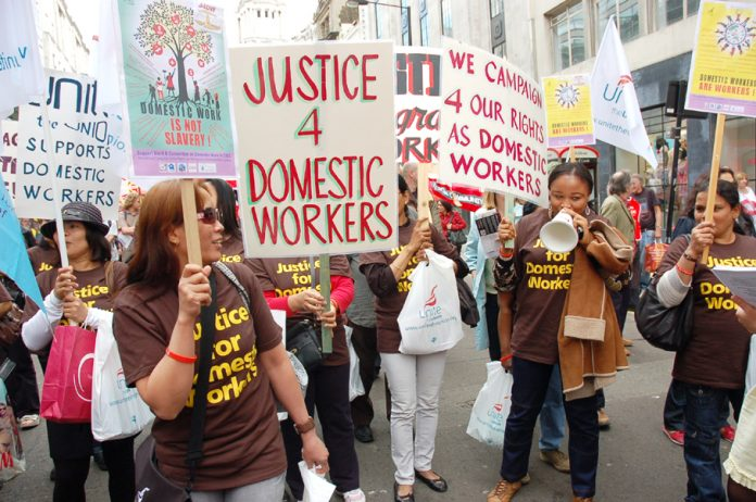 Domestic workers demanding a living wage on this year's May Day march through London