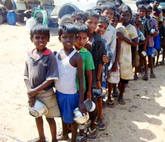 Hungry Tamil children queue for meagre rations