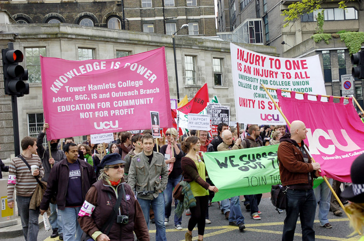 Students and striking lecturers marching from King's College in May against education cuts