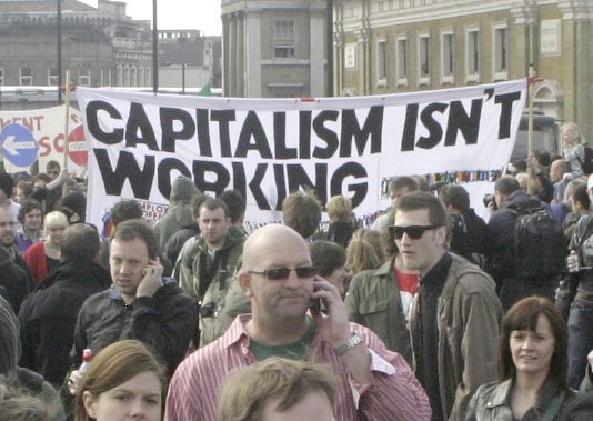 Anti-capitalist demonstrators taking to the streets of London following the crash of the banks in 2008. The crisis of mass unemployment and inflation is intensifying