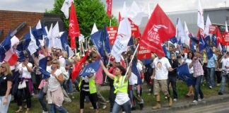 Striking BA cabin crew marching at Heathrow on June 9. They are demanding indefinite strike action to win their dispute