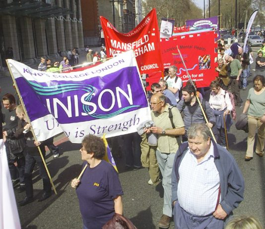 Trade union banners on the march to Defend the Welfare State last April in London