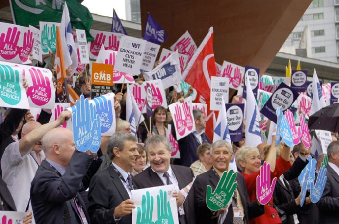 UNISON General Secretary DAVE PRENTIS (second from left) alongside Unite co-leaders SIMPSON and WOODLEY backed by delegates. The three leaders of the two biggest unions in the country are refusing to call for bringing down the coalition government