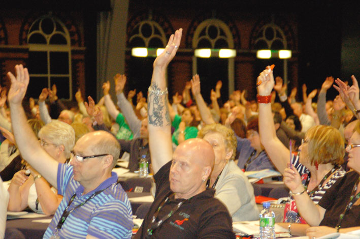 Congress delegates voting for the main resolution on Monday