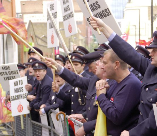London firefighters rallying yesterday outside the London Fire Brigade Headquarters – they are absolutely determined to defend their hard won conditions