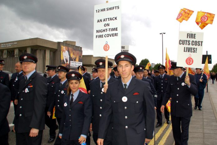 Firefighters turned out on mass to defend their service against the cuts