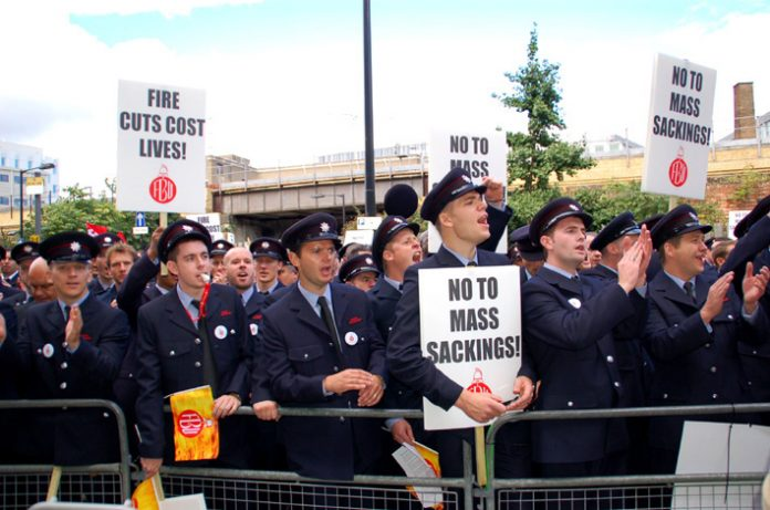 London firefighters on Thursday marched to the Fire Brigade headquarters where they decided to have a strike ballot to defend their jobs