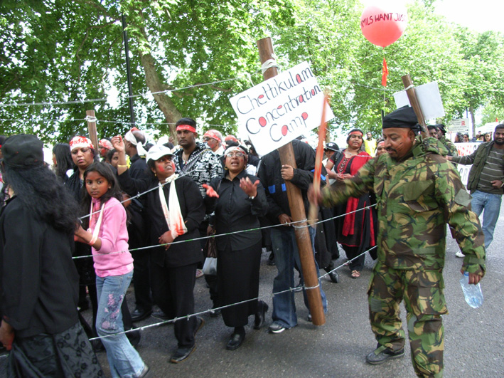 Tamils marching in London enact the horrors facing those interned in the Chettikulam concentration camp by the Sri Lankan army