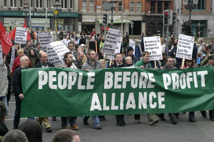 Irish workers march through Dublin against the cost of bailing out the banks