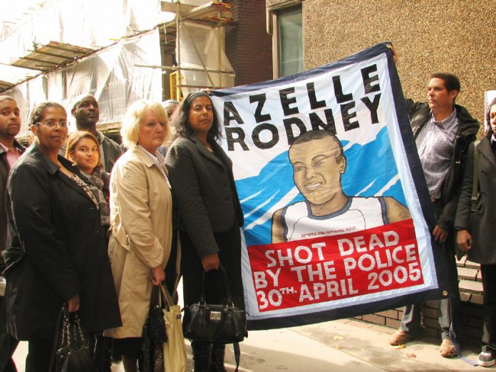 SUSAN ALEXANDER, mother of Azelle Rodney,  (centre, holding banner) and supporters outside yesterday's hearing
