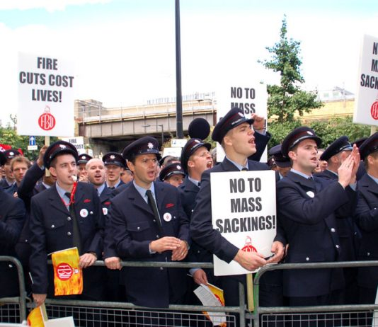 Firefighters lobbing the Fire authority last month demanding 'No cuts'