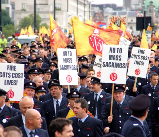 Firefighters marching in London last month against the threat of mass sackings