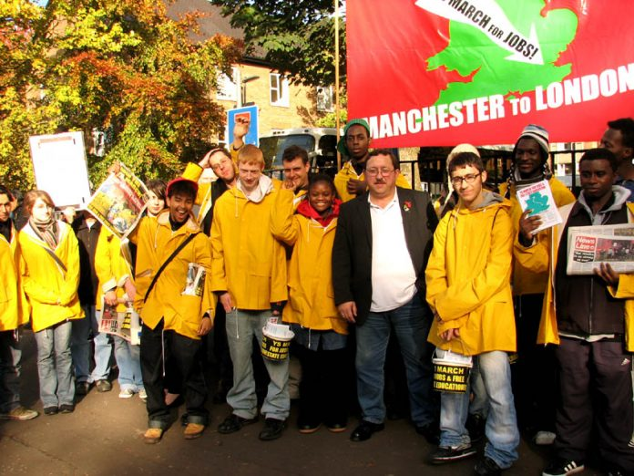 YS marchers assemble with local busworkers union official John Hughes before their march on Saturday