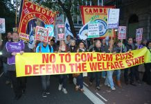 Workers marching on 10 Downing Street to condemn the savage cuts policy of Cameron, Osborne and Clegg