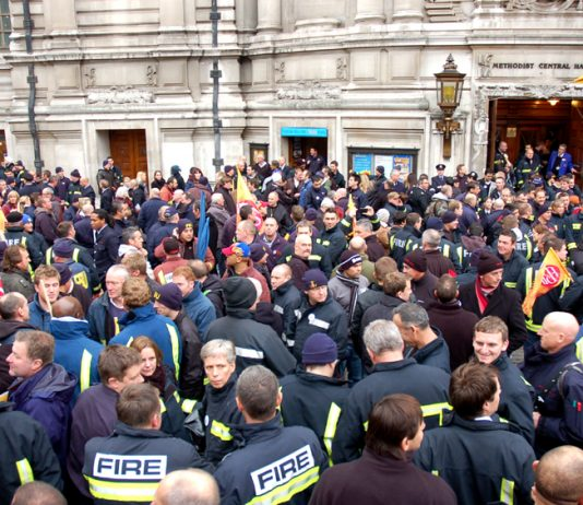 Firefighters gather outside the Central Hall, Westminster after their rally to begin lobbying their MPs