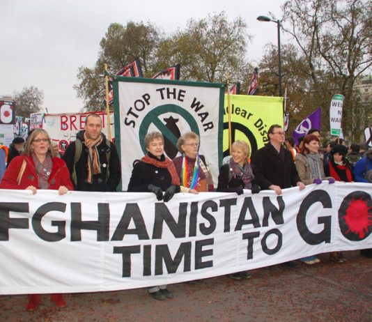 Ex -soldier JOE GLENTON (3rd from left) at the front of Saturday's march against the war on Afghanistan