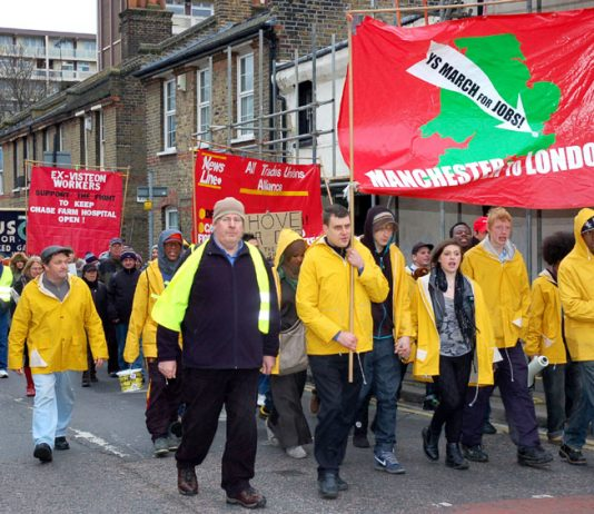 Young Socialist marchers lead the way to yesterday's News Line Anniversary rally in the final mile of their journey from Manchester to London