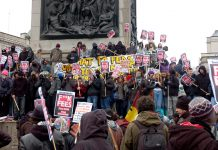 Students gathered in their thousands in Trafalgar Square at midday yesterday and many took up their positions on Nelson's Column