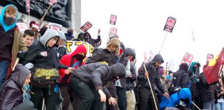 Hundreds of school youth on the plinth at Trafalgar Square before last Wednesday's march on parliament