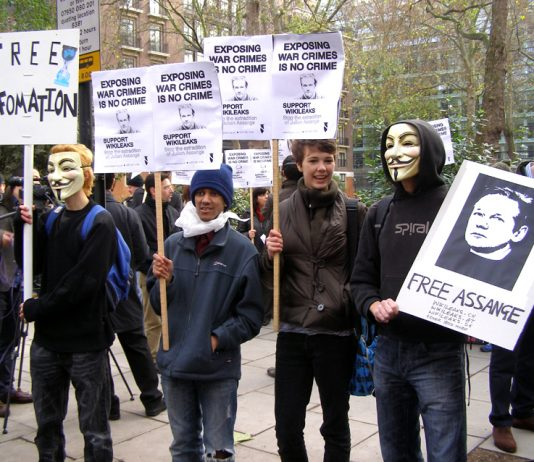 Young demonstrators showing their support for the WikilLeaks founder