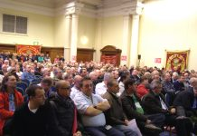 Over 1,000 postal workers rallied at the Central Hall in Westminster yesterday mid-day to fight the plan to privatise Royal Mail which threatens 30,000 jobs