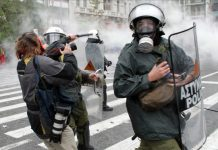Riot police attack MARIOS LOLOS the President of the Greek Union of Press Photographers (EEF) outside the Vouli (Greek parliament) on 15 December.(Photo courtesy of EEF)