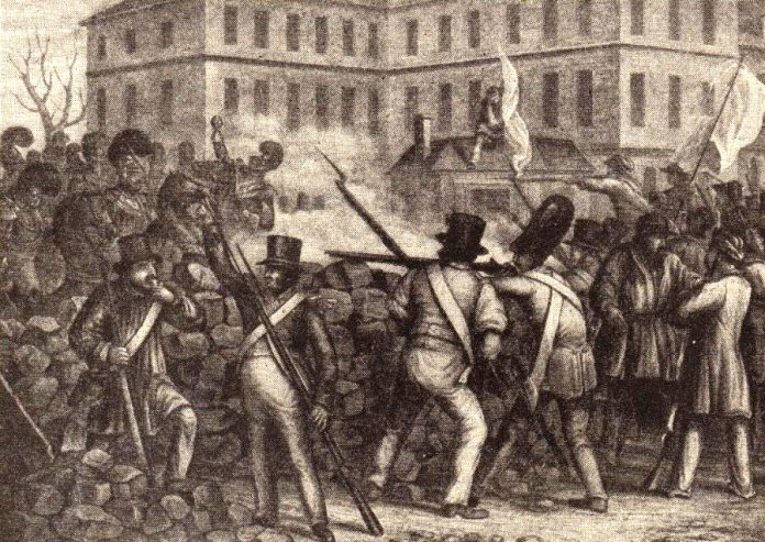 Defending the street barricades in 1848 (From a contemporary print)