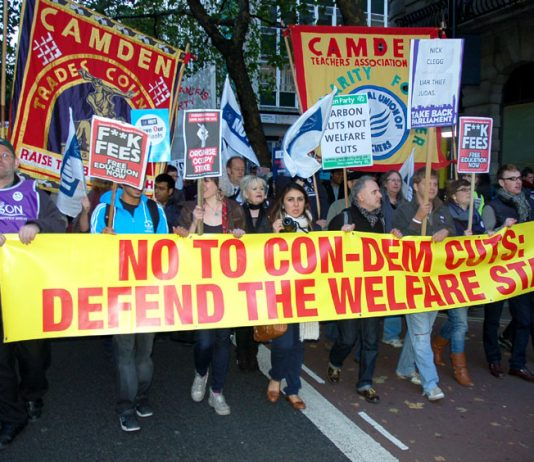 Trade union banners on a demonstration on October 20, the day the coalition's Comprehensive Spending Review  was announced