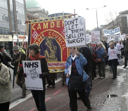 Camden GPs marching against NHS privatisation. Meanwhile the Tory-led coalition says that under-5s don't need anti-flu jabs