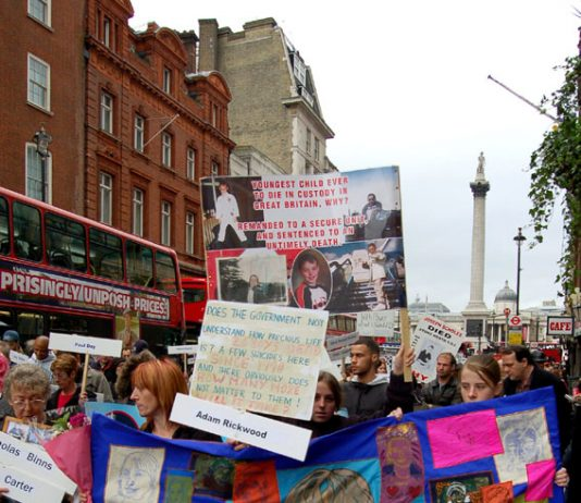 Adam's mother (holding banner on left) during a United Families and Friends march to Downing Street