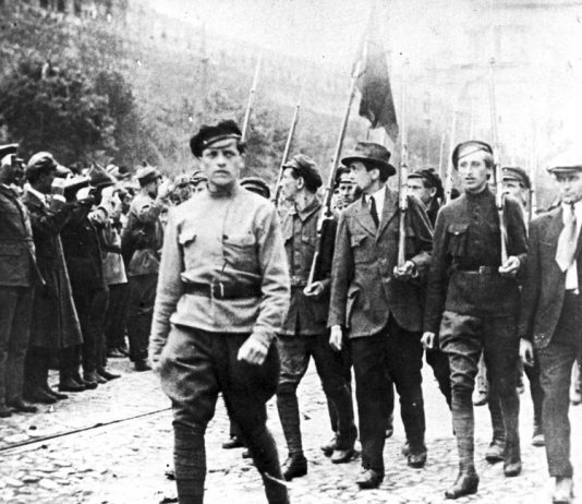 TROTSKY (far left) reviews a Red Square march of workers and soldiers. They were clear that their revolution was the start of the struggle to smash capitalism and imperialism worldwide
