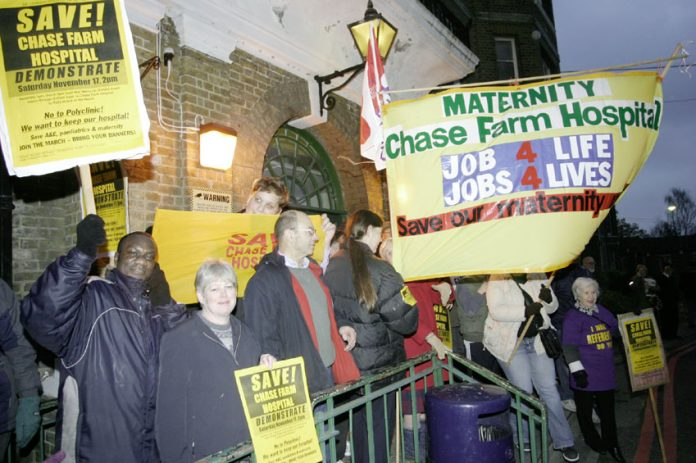 Midwives' banner outside Chase Farm Hospital maternity unit at the start of the campaign by the North East London Council of Action