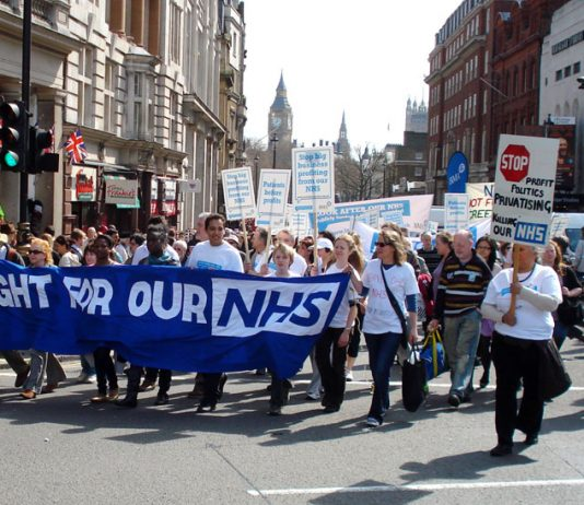 Health workers march through the centre of London to defend the National Health Service