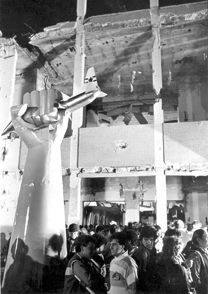 A sculpture of a Libyan arm seizing an American bomber plane, standing outside the home of Muammar Gadaffi, bombed in 1986 – the site from which he gave his speech on Tuesday