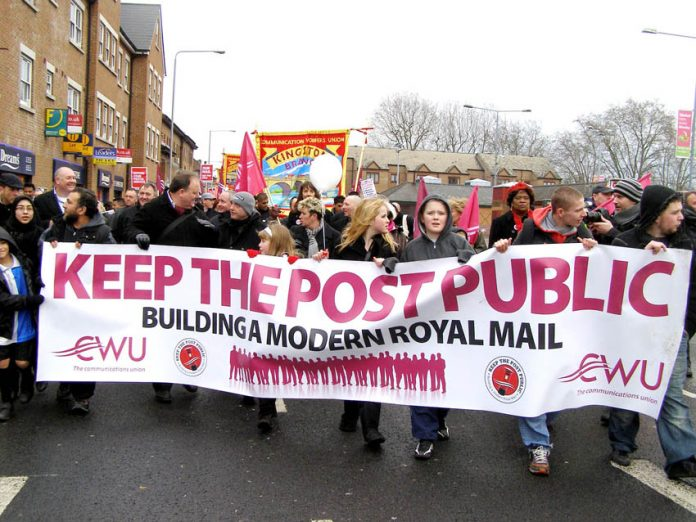 Thousands of postal workers and their families marched through Kingston in January to demand 'Keep the Post Public'