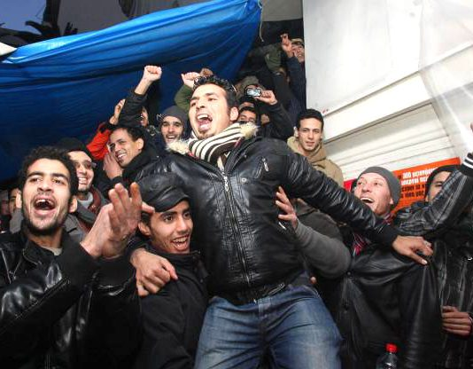 Greek migrant workers celebrate their right of temporary stay and no deportations
