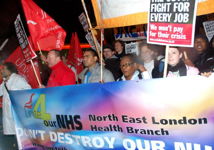 Doctors, nurses and ancillary staff joined a mass march against the destruction of the NHS from the Royal London Hospital to Bart's Hospital on Wednesday