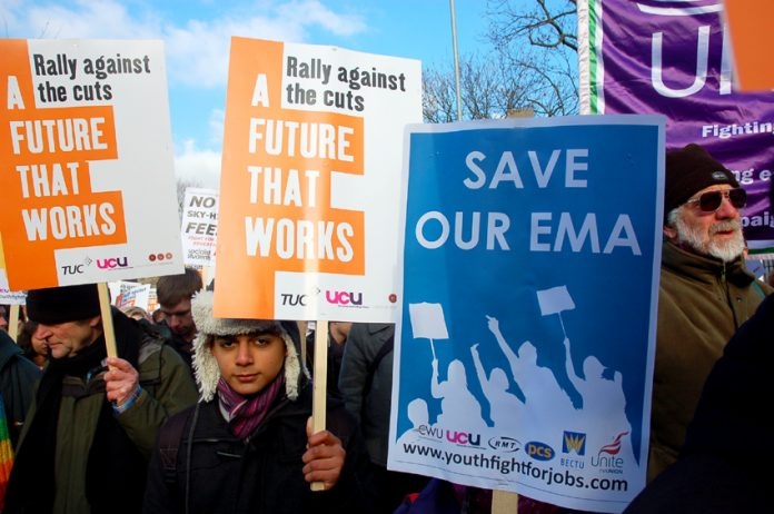 Placards held aloft on the NUS/TUC march in Manchester in January