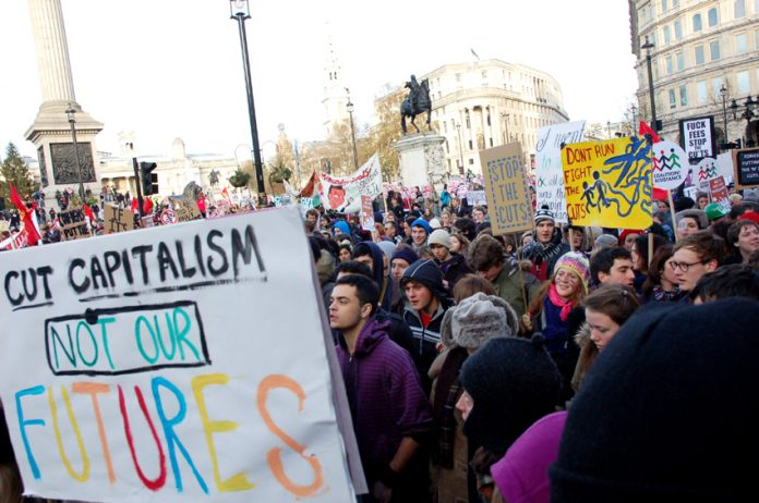 A section of the 100,000-strong march against £9,000 tuition fees passing by Trafalgar Square on December 9 last year