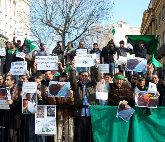 'We all support Colonel Gadaffi' demonstrating Libyan students insisted outside Downing Street yesterday