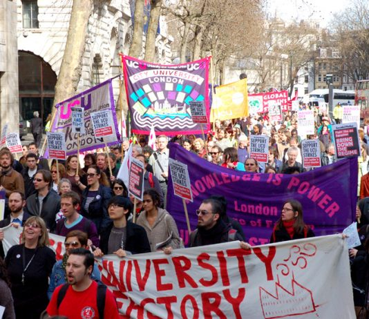Yesterday's march by lecturers and students heads towards Whitehall from the London School of Economics