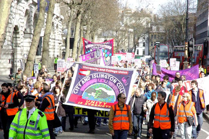 Striking lecturers marching on Thursday in London as part of their national strike action in defence of pensions and in opposition to wage cuts