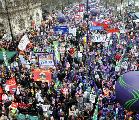 Half a million workers and youth joined Saturday's march, with banners, placards, flags and balloons