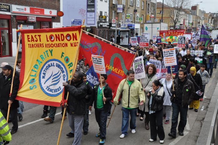 Two thousand teachers and Unison members marched through Tower Hamlets yesterday