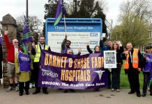 Yesterday's picket of Chase farm Hospital with Unison Regional officer DEREK HELYAR (at left of banner)