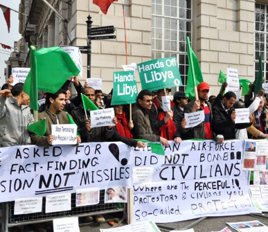 Banners on the mass picket of the Contact Group's first meeting in London last month exposing the lies of the imperialists about the war they have launched against Libya