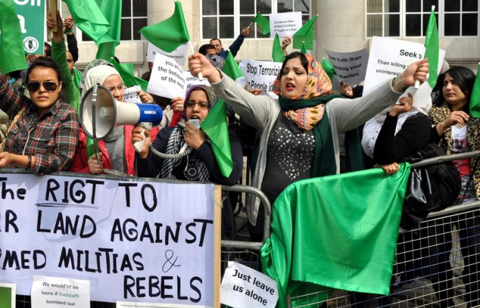 Libyan women, proclaiming their right to defend their country against armed rebels, picketing the recent Contact Group meeting in London