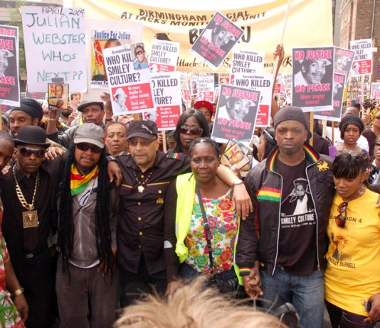 The family and friends of Smiley Culture lead a march of thousands of people to New Scotland Yard on Saturday. Others whose loved ones have died in police custody also joined the march